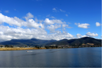 The serene bay in Hobart, Tasmania with Mount Wellington in the background.