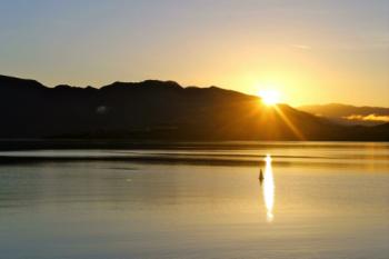 Sunrise reflecting in the water near Wanaka.