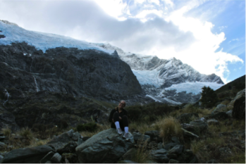 Sitting on a boulder beneath Rob Roy Glacier.