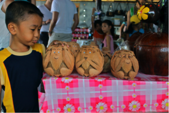 A new friend at a market on the Mekong Delta, showing me his favorite coconuts.